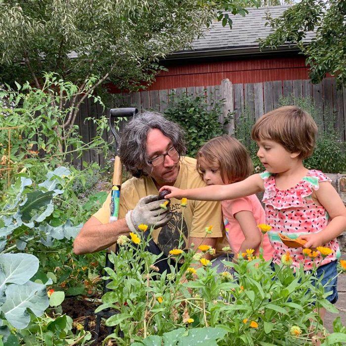 Aaron & two children in the garden