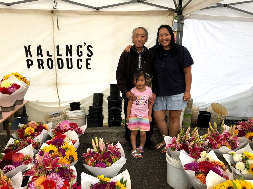 Family Vendor at Beaverton Farmers selling flowers